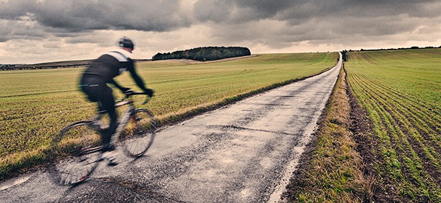 Lone Cyclist in UK Countryside
