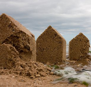 Crumbling sand shaped houses