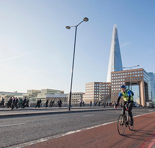 England, London, Southwark, Cyclists Crossing London Bridge