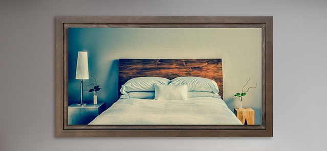 Beautiful Clean and Modern Bedroom with fun Canvas on the Wall that is a repetition or infinity concept