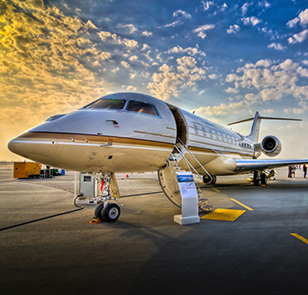 Image of a private jet at an airshow during sunset (golden hour)
