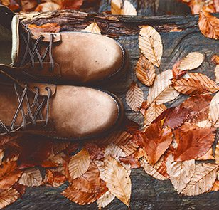Boots in autumn leaves
