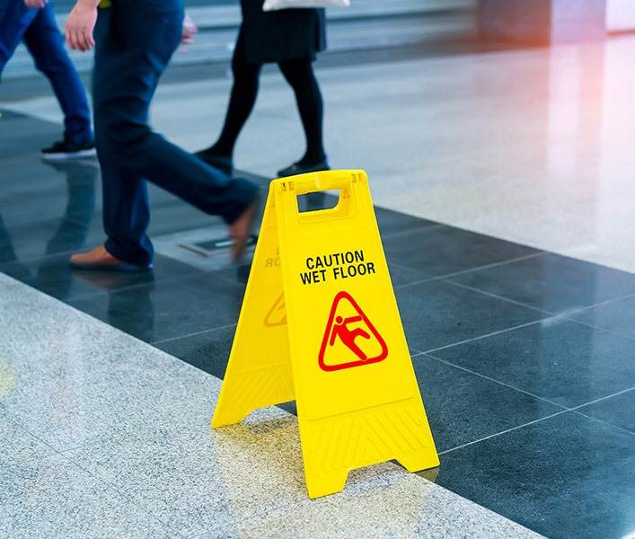 wet floor sign on tiled floor