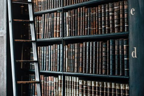 Antique collection of books on bookshelf