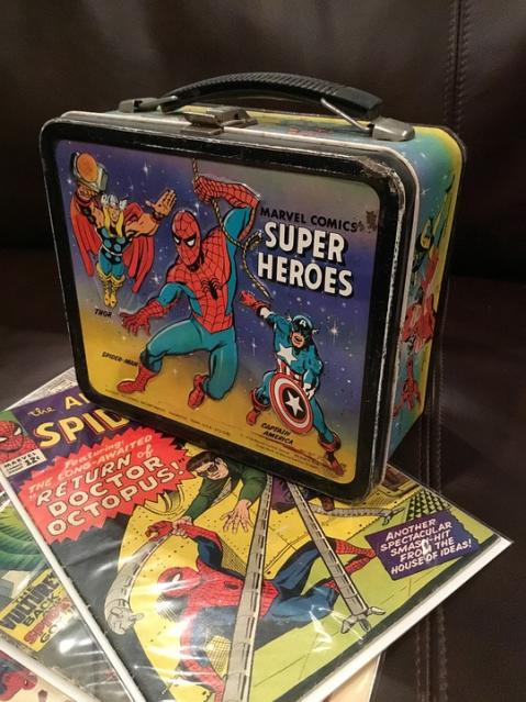 Spider-Man lunchbox with comic book collection