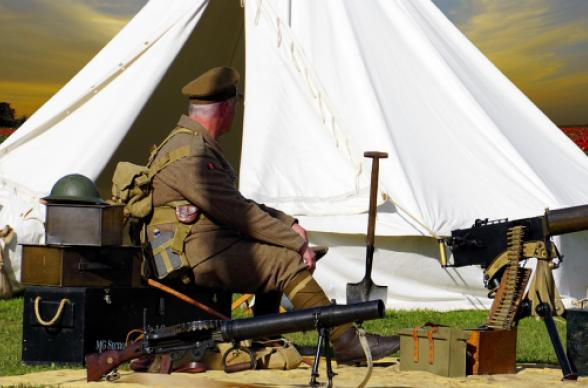 soldier in front of tent