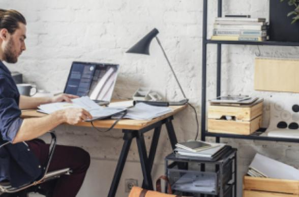home office wooden desk shelves laptop